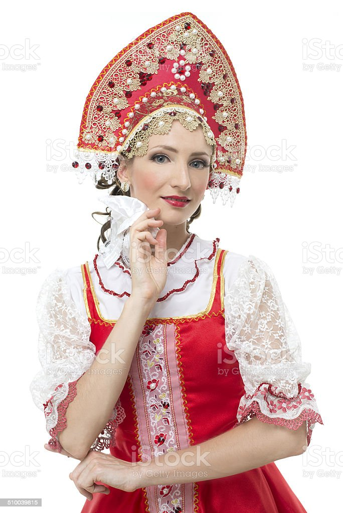 Smile coquettish young woman portrait in russian traditional costume stock photo