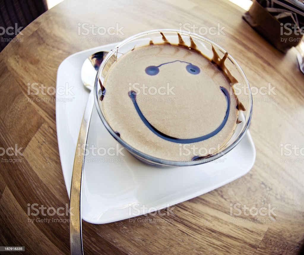 smile face in a cup of coffee at bar royalty-free stock photo