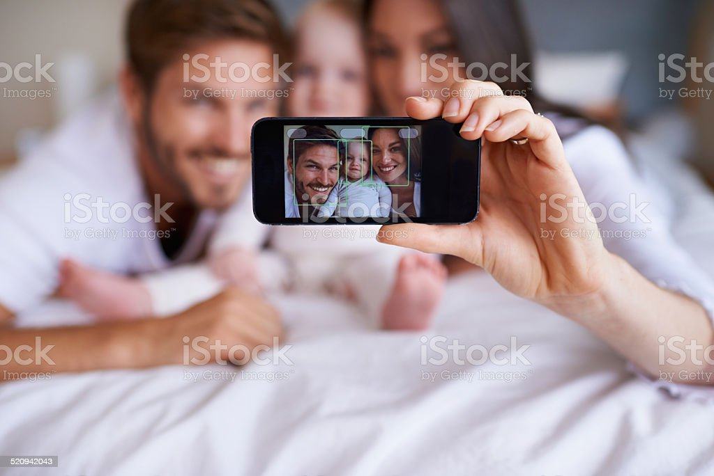 Smile for the family selfie stock photo