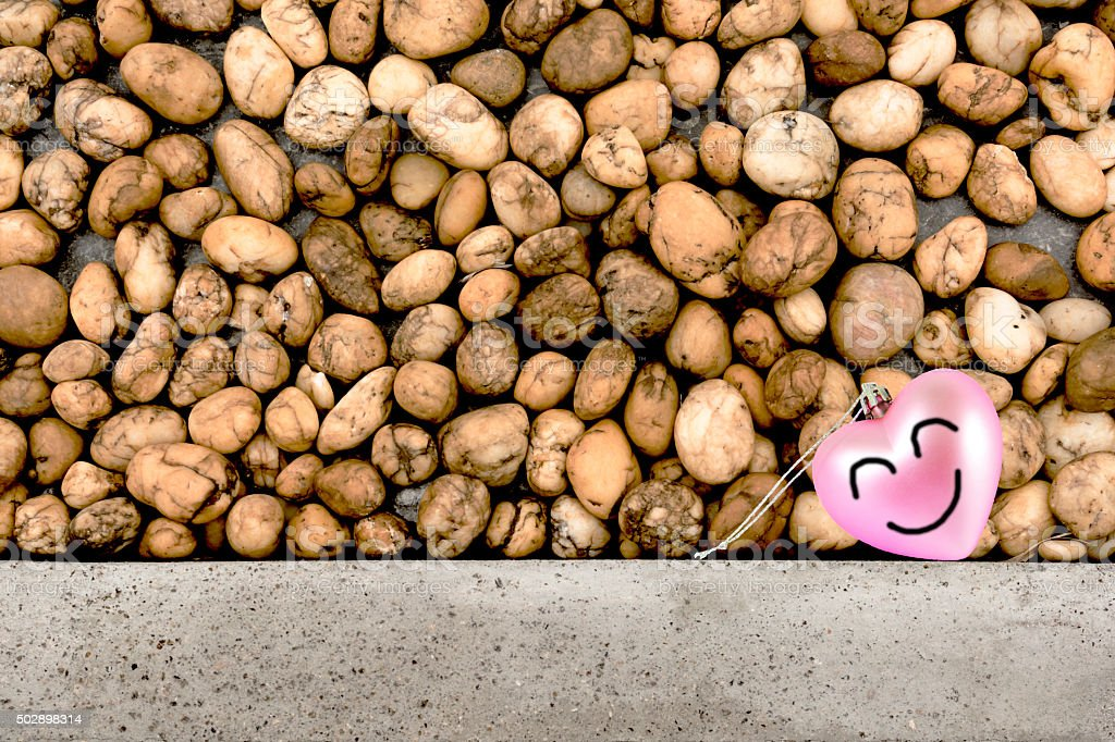 Smile heart and small stones in background. royalty-free stock photo