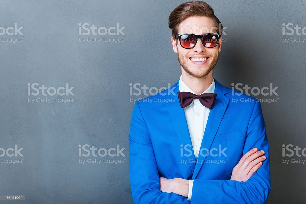 Smile is a part of his style. stock photo