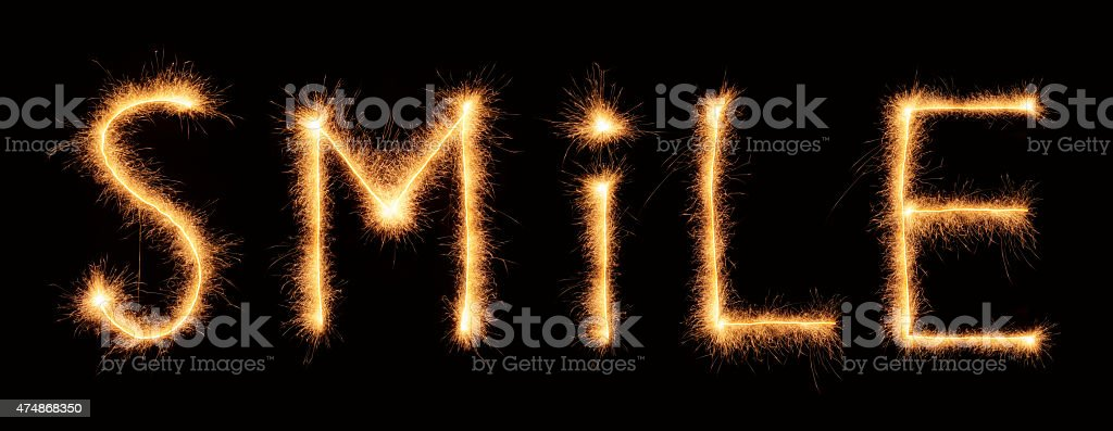 'Smile' lettering drawn with bengali sparkles stock photo