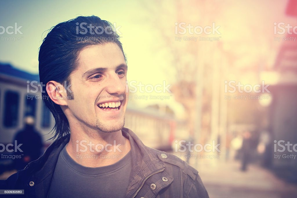 Smile Man in Train Station stock photo