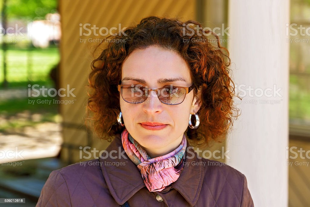 Smile of a beautiful woman in glasses stock photo