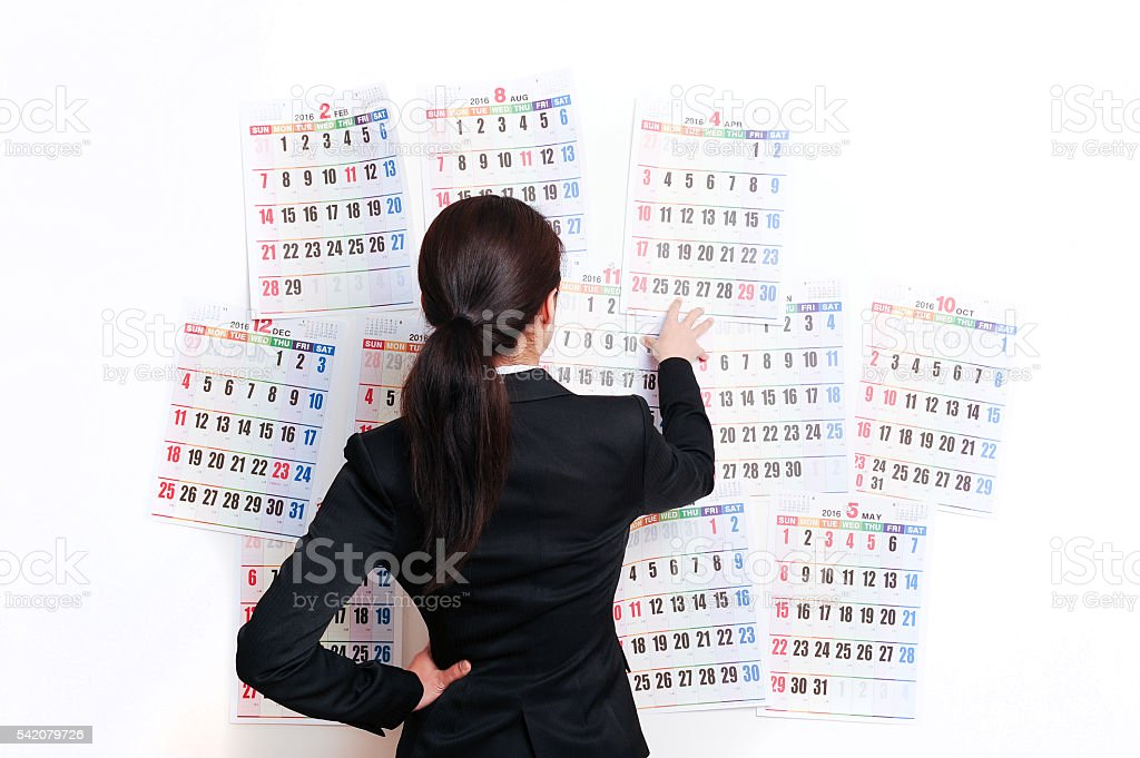 Smile of business woman in front of the calendar stock photo
