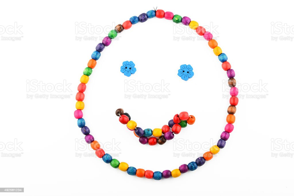 Smile of colorful wooden beads isolated on white royalty-free stock photo