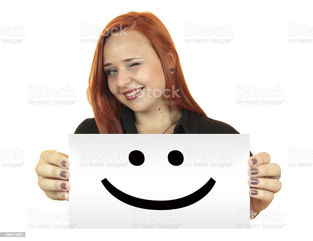 Smile. Smiling young woman holding up white banner royalty-free stock photo