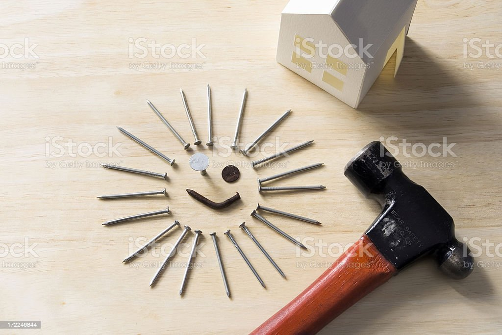 Smile - we're fixing it up! stock photo
