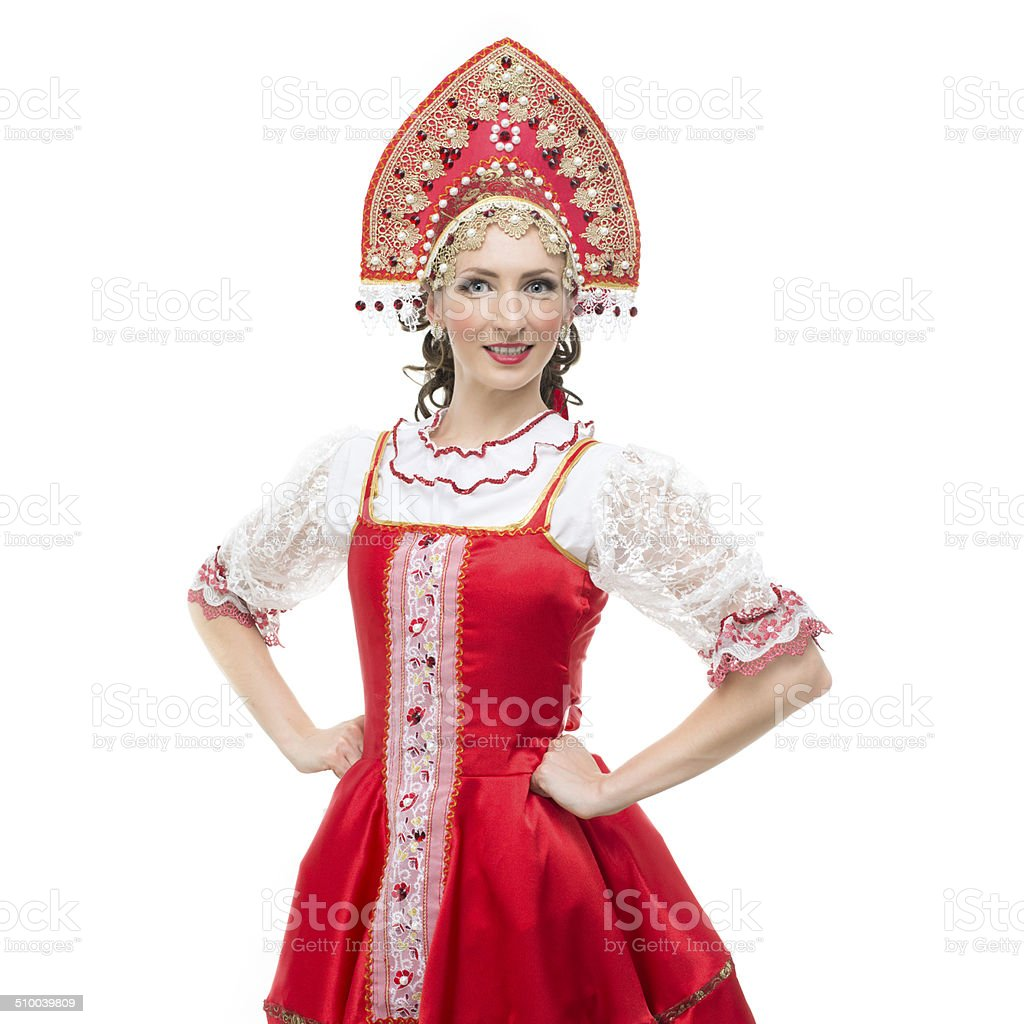 Smile young woman in red sarafan and kokoshnik stock photo