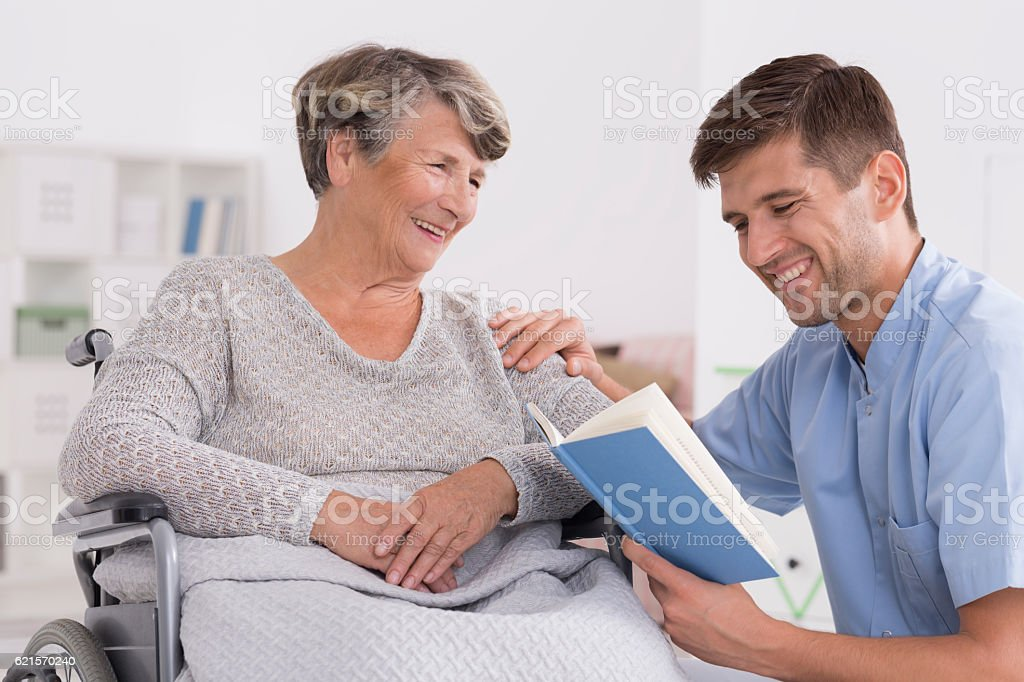 Smiled senior woman on wheelchair stock photo