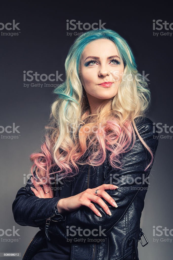 Smiled young woman with multicolored hair - portrait stock photo