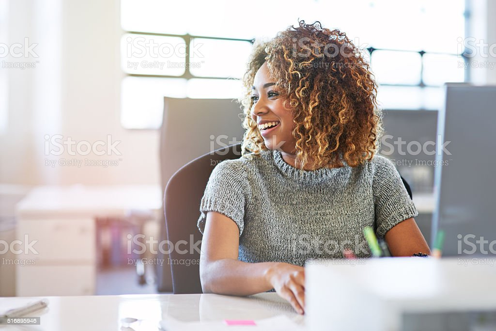 Smiles all round in this office stock photo