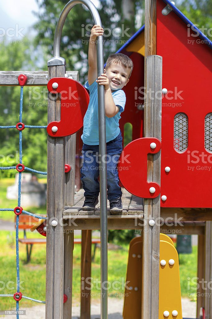 Smiley boy on playgroung royalty-free stock photo