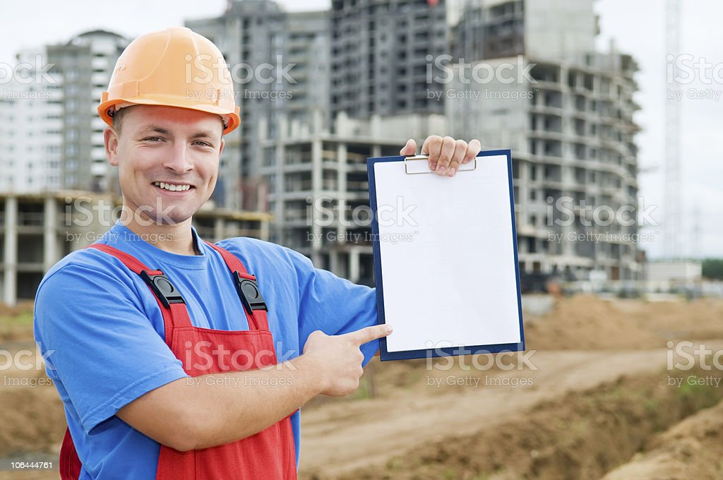 Smiley builder with clipboard royalty-free stock photo