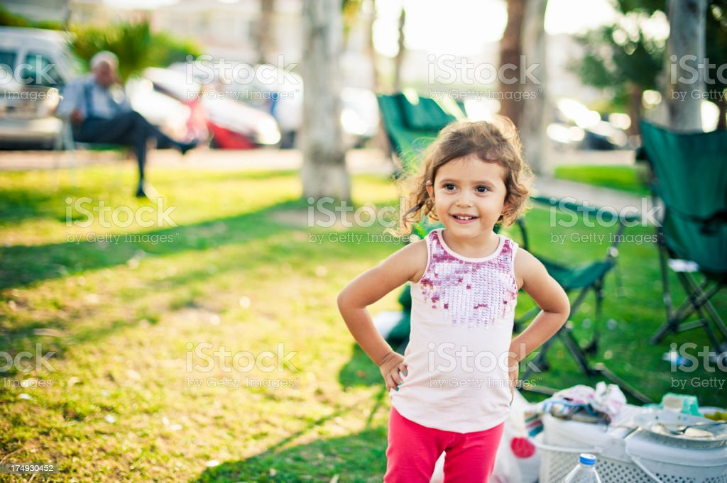 Smiley cute little girl at the picnic royalty-free stock photo