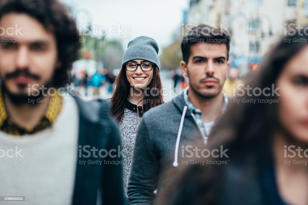 Smiley face in the crowd stock photo