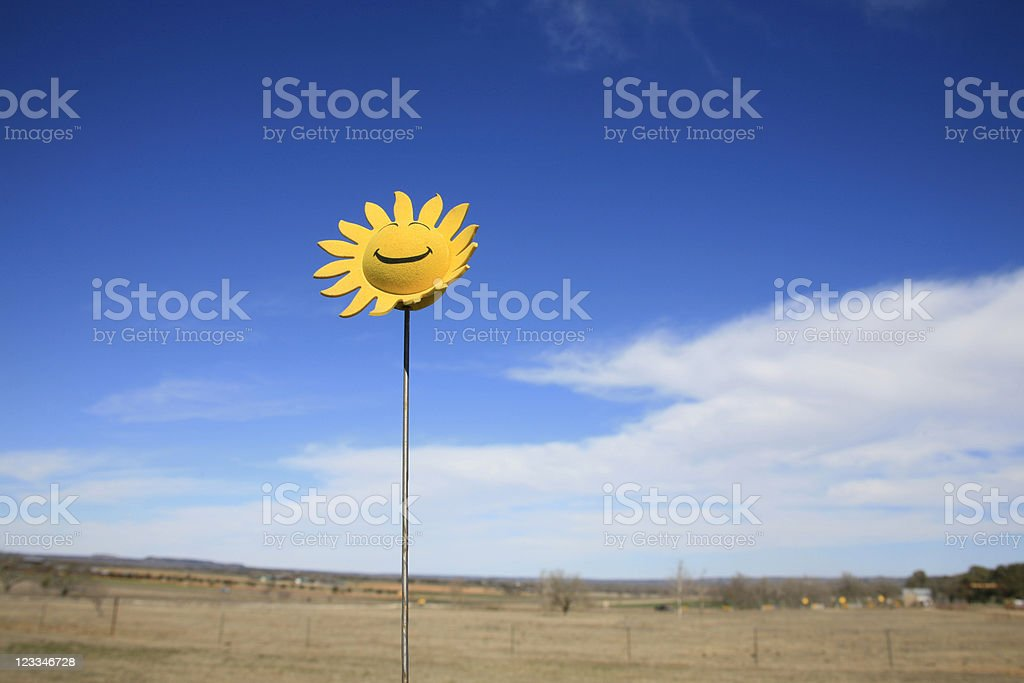Smiley face sun in the sky royalty-free stock photo