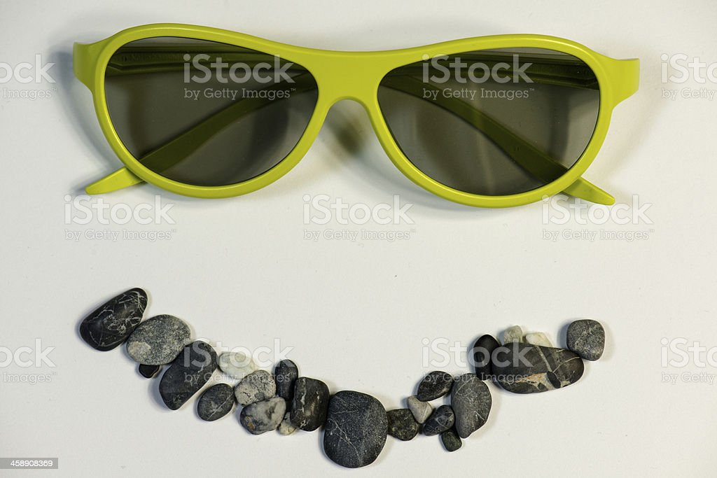 smiley face wearing green glasses royalty-free stock photo
