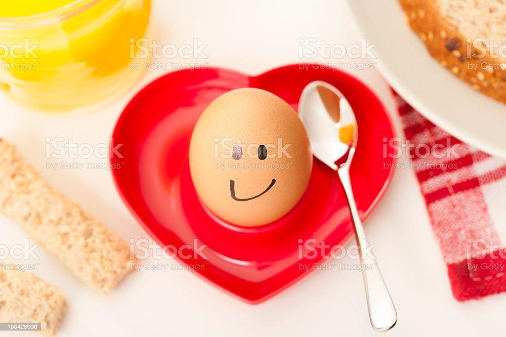 Smiley faced boiled egg stock photo