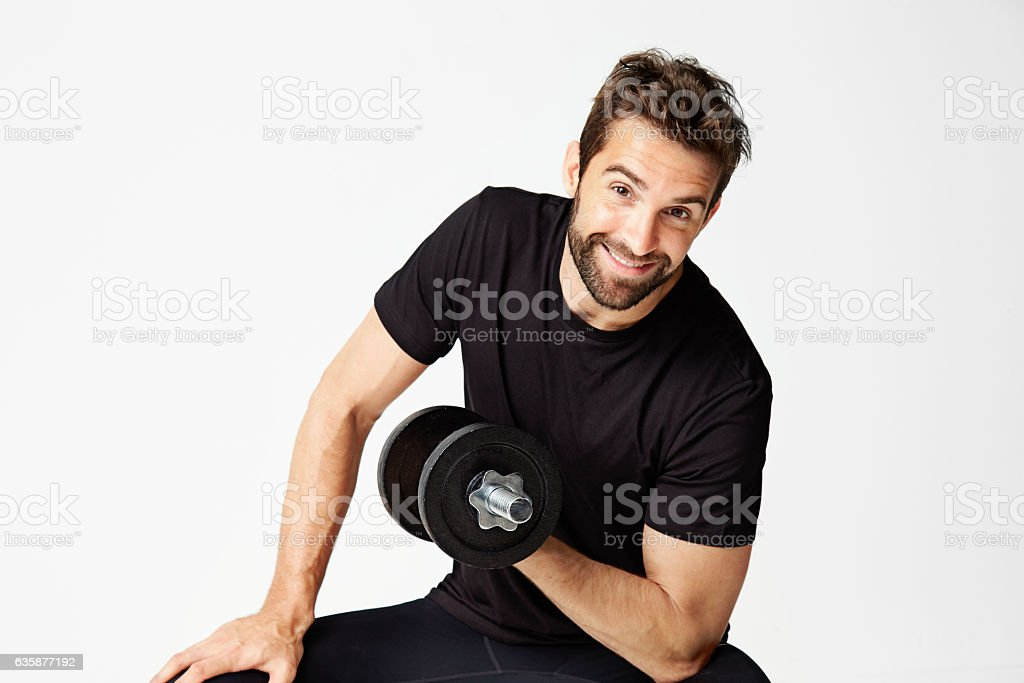 Smiley guy lifting weight stock photo