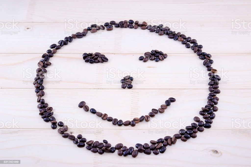 Smiley made entirely out of coffee grains royalty-free stock photo