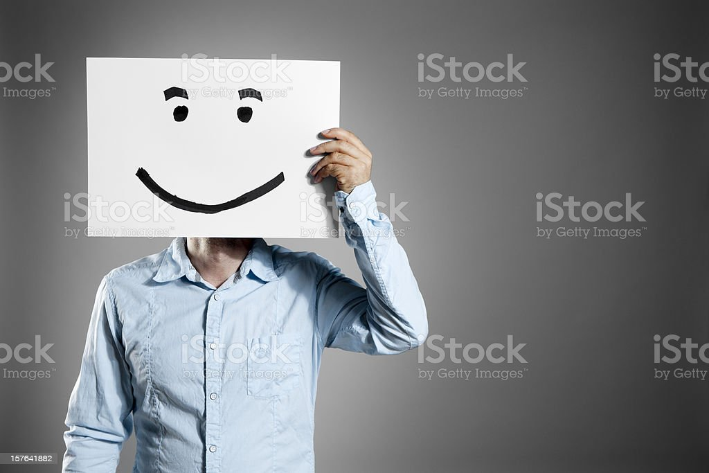 Smiley man. Business Mask Face Smiling Holding Hand Paper stock photo