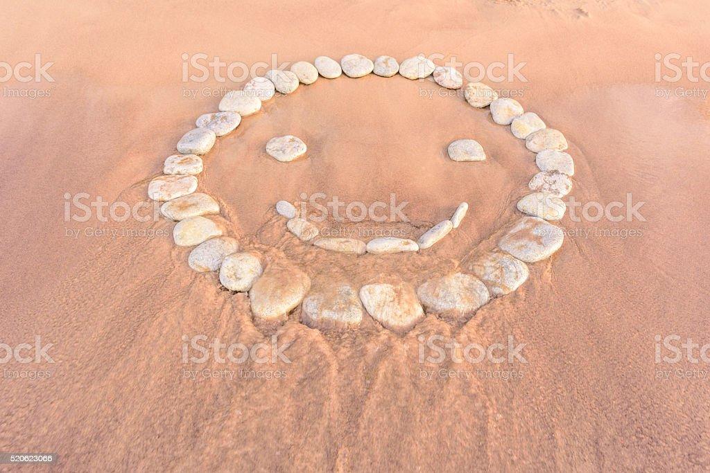 Smiley on sandy beach stock photo