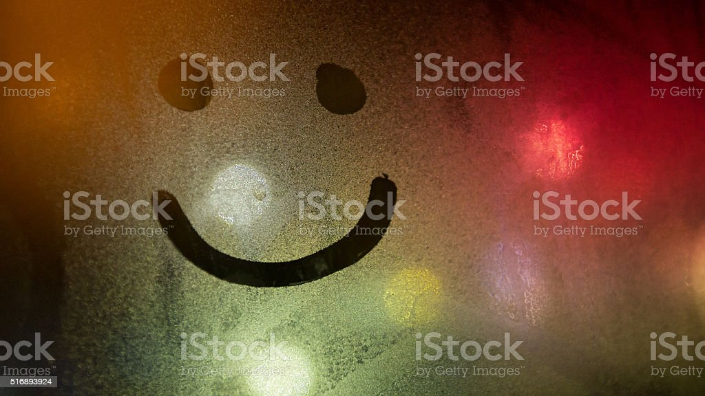 Smiley on the foggy glass stock photo