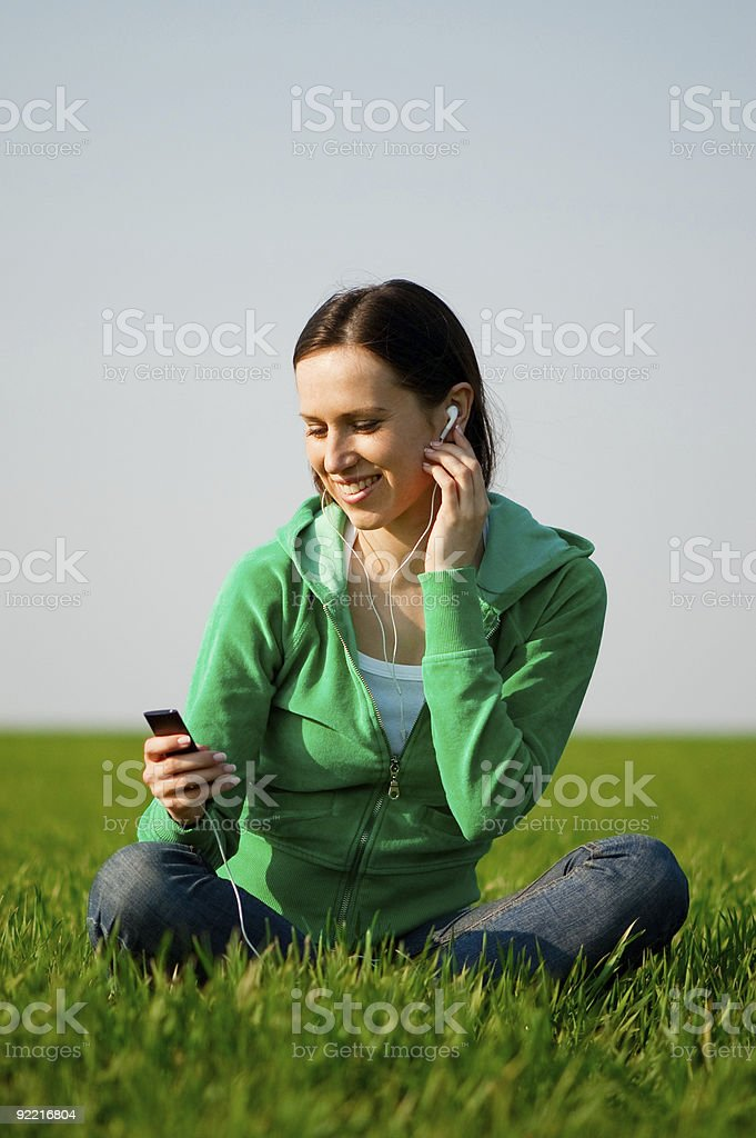 smiley woman listening music royalty-free stock photo