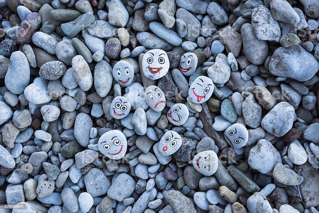 Smileys on pebbles stock photo
