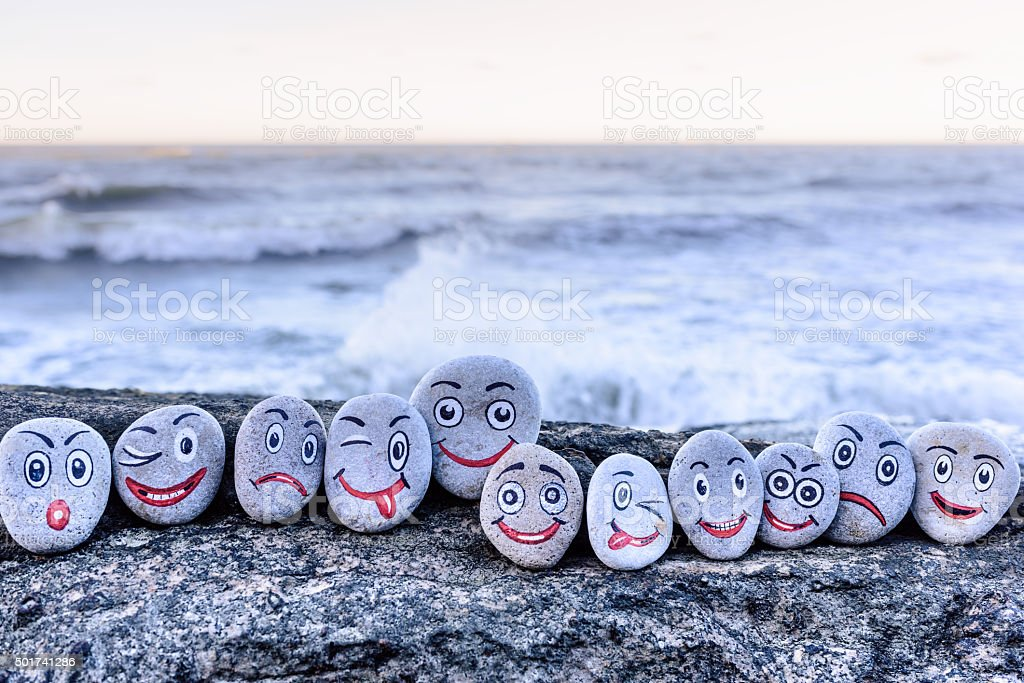 Smileys on small stones stock photo