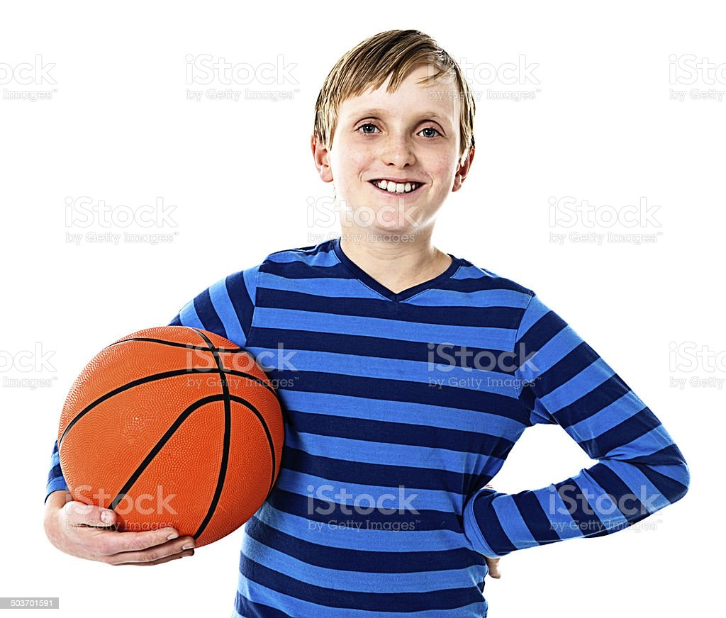 Smiling 11-year-old boy challenges you to a game of basketball stock photo