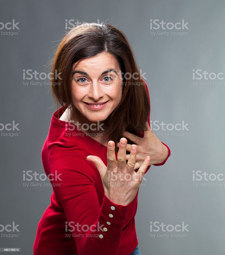 smiling 30s female comedian waving like at theatre stock photo