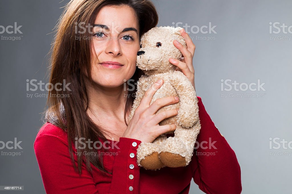 smiling 30s girl showing the symbol of childhood stock photo