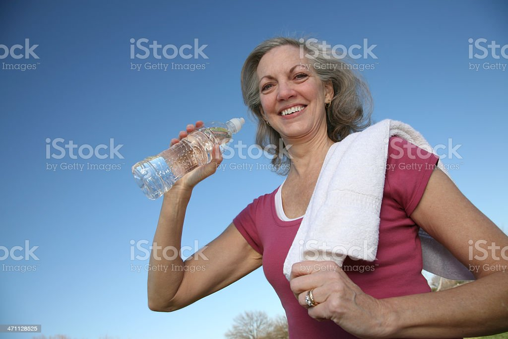 Smiling Active Adult Drinking Water royalty-free stock photo