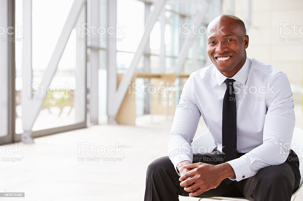 Smiling African American businessman, horizontal portrait stock photo