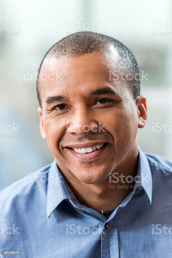 Smiling African American businessman looking at camera. stock photo