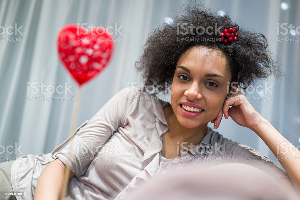 Smiling African American woman enjoying at home. stock photo