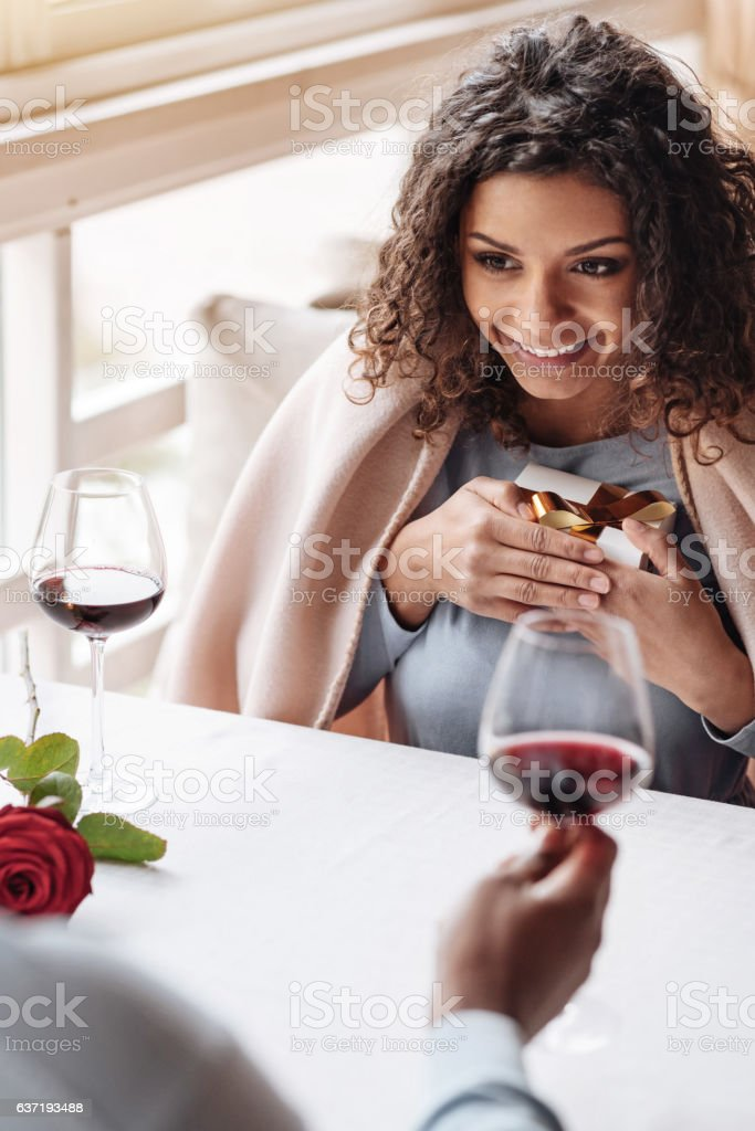 Smiling African American woman having the date in the restaurant stock photo