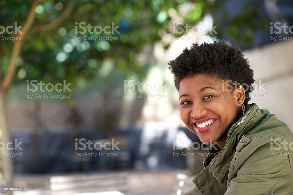 Smiling african american woman outdoors stock photo
