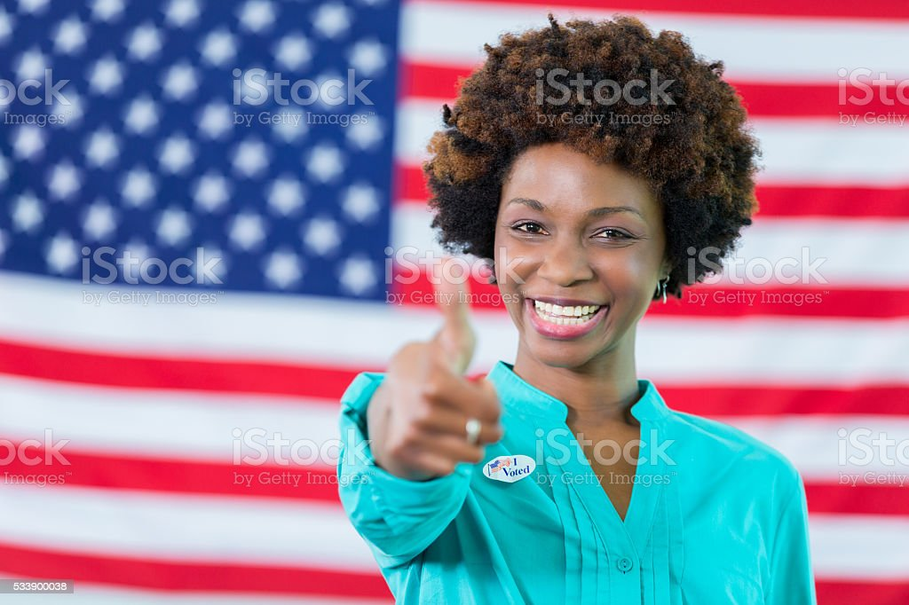 Smiling african american woman voted stock photo