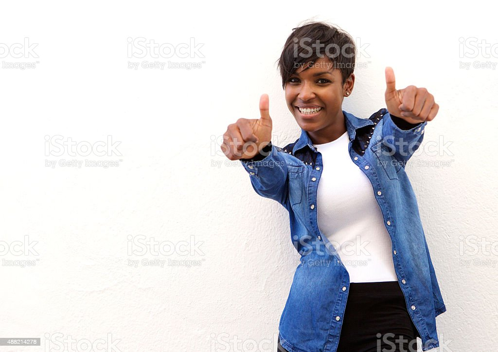 Smiling african american woman with thumbs up stock photo