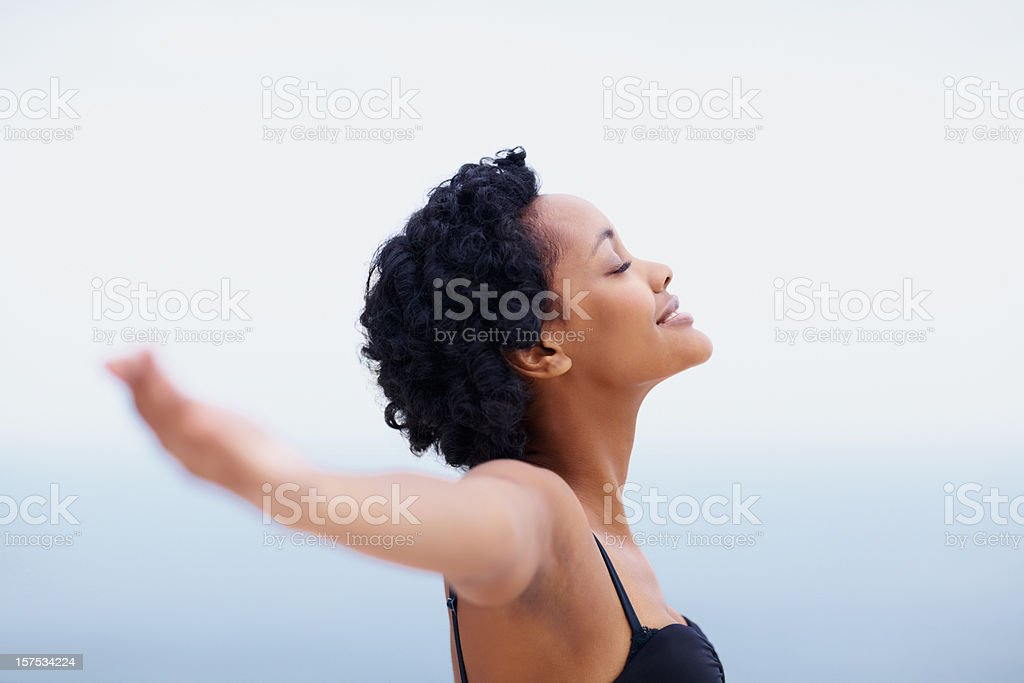 Smiling African American young lady with arms outstretched royalty-free stock photo