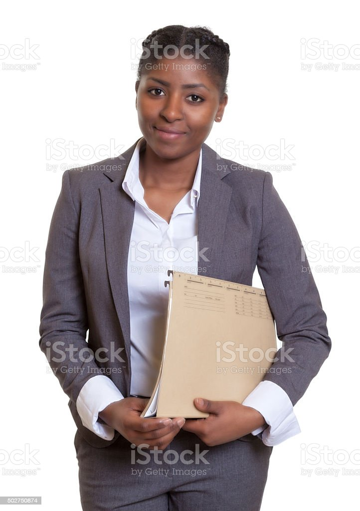 Smiling african business woman with file stock photo