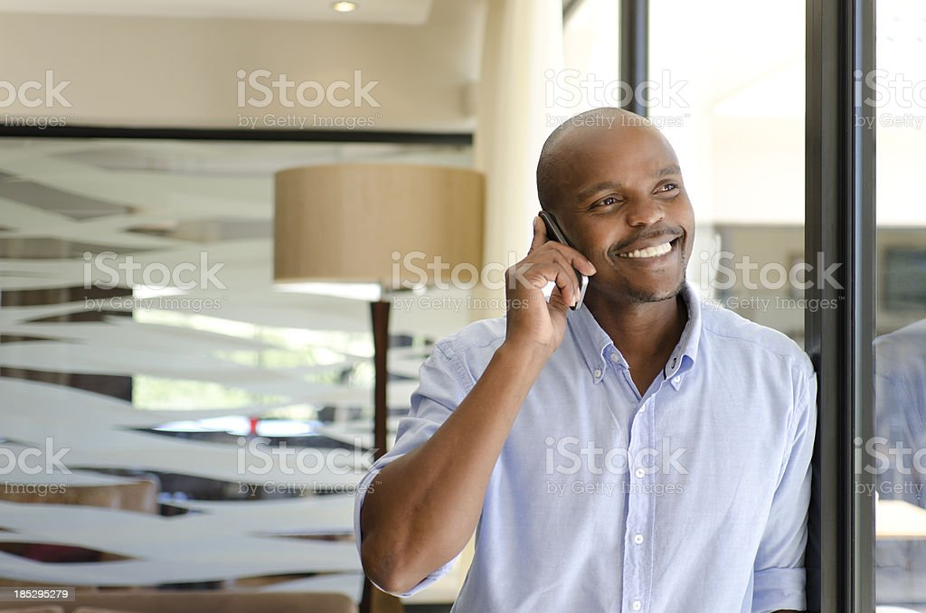 Smiling African businessman on the phone royalty-free stock photo