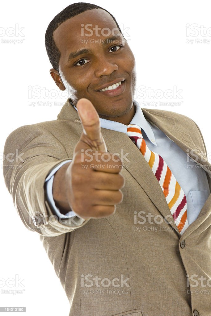 Smiling African ethnicity male in business suit gesturing thumbs up stock photo