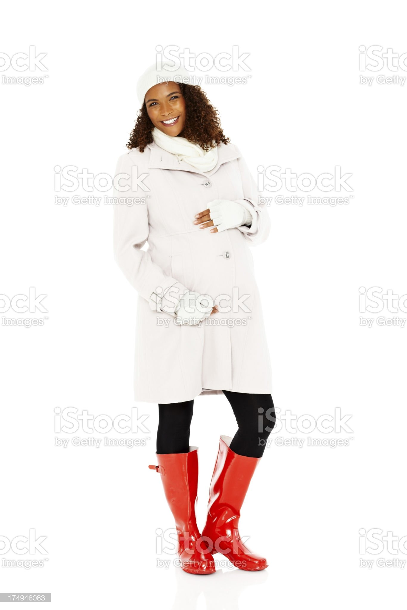 Smiling African pregnant woman standing relaxed on white royalty-free stock photo