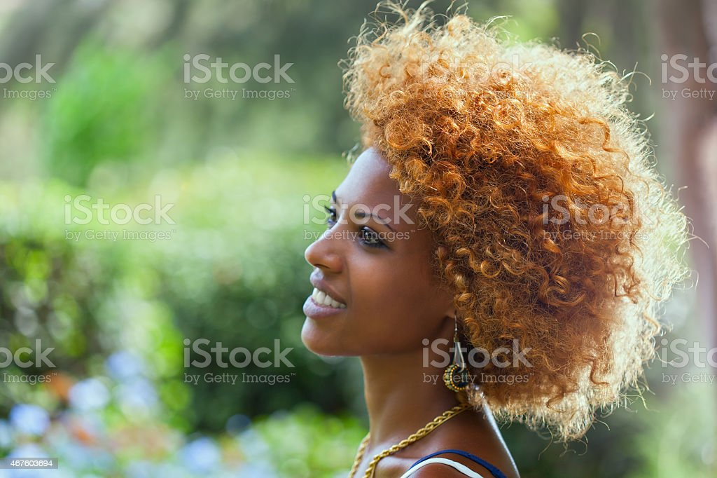 Smiling African woman. Outdoors profile portrait stock photo