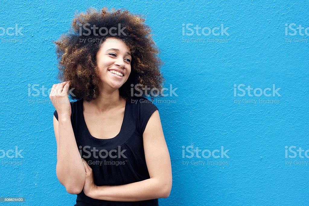 Smiling african woman with afro hairstyle stock photo