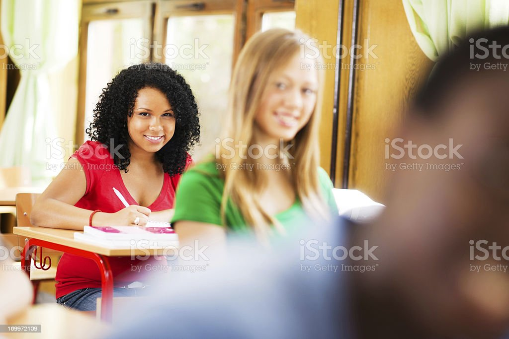 Smiling African-America girl writing in her notebook. royalty-free stock photo